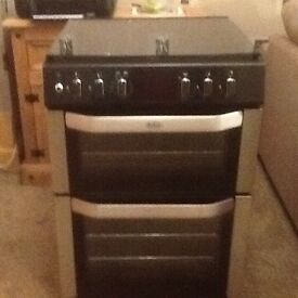 Freestanding Dual Electric Oven and Gas Hob.