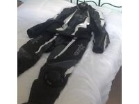 RST 2 piece motorcycle leathers, size 46, excellent condition only ever worn twice.