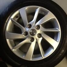 """4 x Nissan Pulsar 16"""" factory mags with genuine chrome wheel nuts Prestons Liverpool Area Preview"""