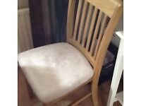 Extending solid wood table and 4 chairs still in Argos catalogue new 250 good condition