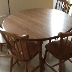 Round wooden dining table and 4 chairs, good condition