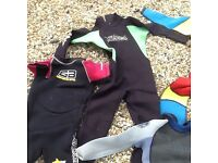 Seven childrens wetsuits and booties. Five pounds each or twenty five pounds for them all.