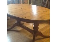 Vintage Ducal oval pine table and chairs for sale