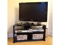"Immaculate Black glass tv stand with metal frame (already assembled) 84cmx45cm 33""X 18"""