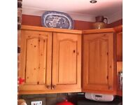 Solid pine kitchen cupboards,sink and mono block tap.