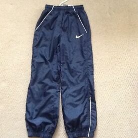 Nike navy tracksuit bottoms, size 8-10 yrs, Immaculate condition