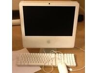 iMac (white) desktop computer with Apple keyboard and mouse