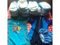Huge bundle of Huggies little swimmers pants plus 3 swimming outfits.