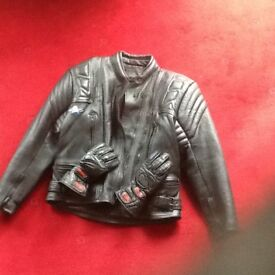 Woman's motorcycle jacket and gloves