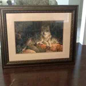 Framed print of wolves