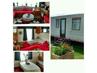 **A secure welcoming 6-8berth caravan on PrestHaven sands,Holiday resort, Gronant, Prestatyn **