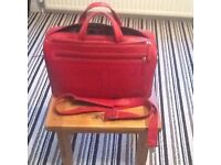Red leather briefcase, hardly used, perfect to carry all you would need for a day at the office.