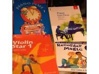 Singing, piano, keyboard, recorder and violin books for sale.
