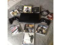 PS3 Super Slim Console & 8 Games
