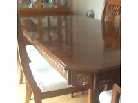 Mahogany extending dining table and six chairs complete with display unit.