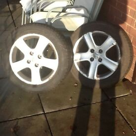 Two winter tyres fitted on Peugeot 307 alloy rims