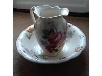 Very pretty jug and wash bowl.