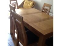 Solid oak table and 6 padded chairs. 90x90cm closed. 135 x 90 cm extended. Excellent condition