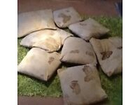 9 coordinating cushions of various sizes , attractive beige and cream pattern , all have zip fastens