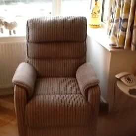 Riser recliner armchair. Chenille check fabric. 1 yr old hardly used. V quiet.