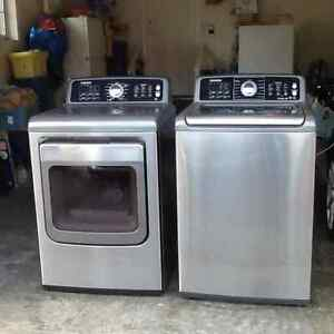 Top loading Samsung washer and dryer.
