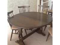 Priory Extending Oak Dining Table with 6 chairs including a carver. Excellent condition .