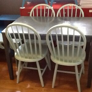 Small table with 4 blue chairs