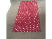 Pair of pink polka dot curtains