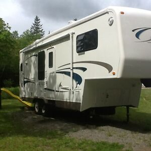 Original It Is In Very Good Condition 345 Feet Long Has A Nice Spacious Lay Out Which Is One Of The Reasons We Purchased This Particular Trailer It Has 3 Slide Outs , Sleeps 4 And Has A 3 Piece Bathroom This Trailer Has Too Many Options To List
