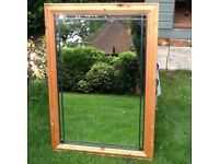 Large antique pine framed mirror with small coloured glass decoration in each corner.