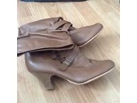 Ladies boots with a few marks size 38