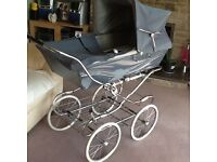 1970's pram in need of tlc. Brake in good working order. White canopy included. £40