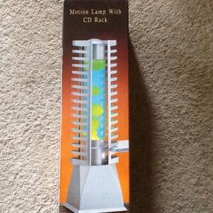 Motion lamp with CD rack on both side