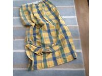 Pair of check curtains with tie backs