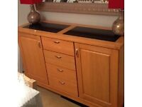 Sideboard with inlaid black marble top