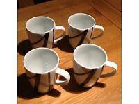4 coffee mugs - from Ben de Lisi.