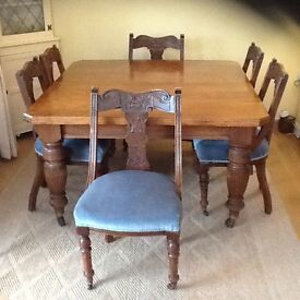 Solid dark oak extending dining table with 6 chairs