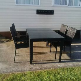 Black rattan patio set with bench