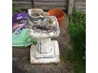 Stone boot planter.