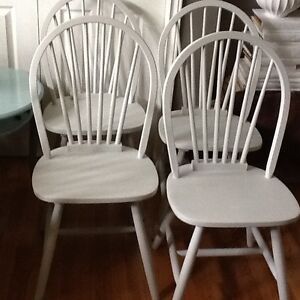 Four grey chairs