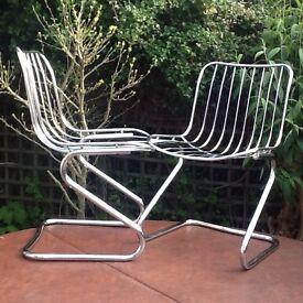 Pair of retro style chrome tube seats