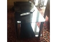 Coffee dark glass table with shelf under with Crome legs in good condition
