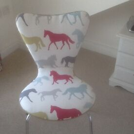 Chair upholstered in horse fabric