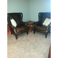 Beautiful leather high back wing chairs.