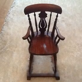 A beautiful antique rocking chair to put your doll in.