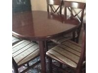 Mahogany colour dinning table and 6 chairs for sale in Bamford Hope Valley