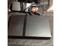 PlayStation 2 slim with 10 games and accessories
