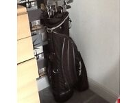 Top flight golf bag with clubs and golf trolley