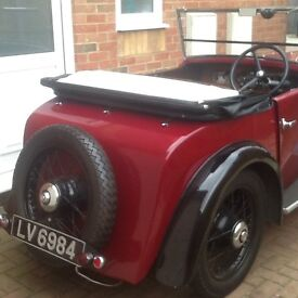 Classic 1934 morris minor 2 seater sports soft top colour red with wire wheels 8hp engine