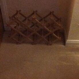 Wooden concertina wine rack